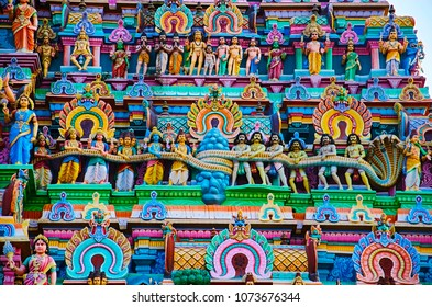Colorful idols on the Gopuram of Nataraja Temple, Chidambaram, Tamil Nadu, India.