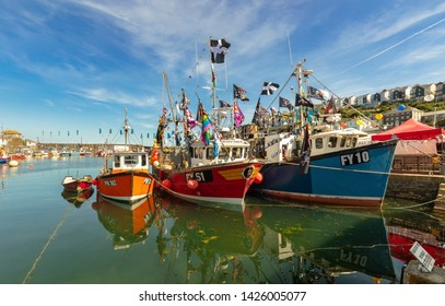 A colorful and idyllic little harbor with many fishing boats in the south of England. The city in Cornwall is called Mevagissey. 6/25/2018, Mevagissey , UK, 4.29 p.m.