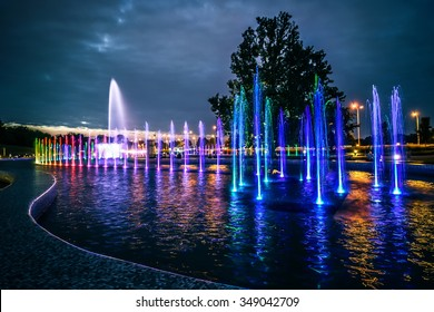 colorful illuminated musical fountain in Warsaw at dusk