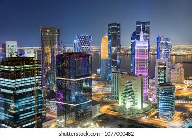 The colorful illuminated skyline of Doha, City Center, Qatar