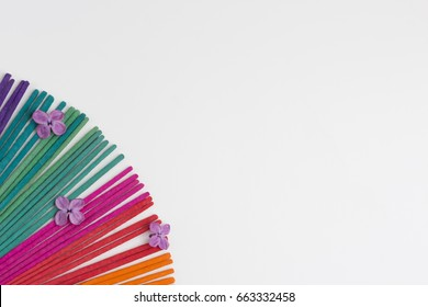Colorful incense on white background. Top view