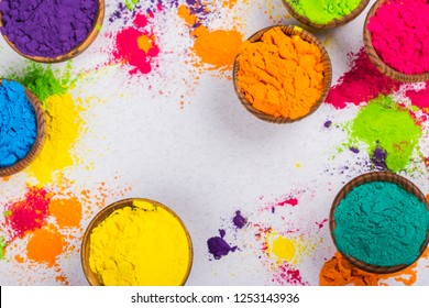 Colorful Indian powder paints for Holi festival in wooden bowls