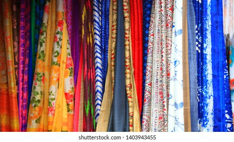 Colorful Indian women costumes up for sale.