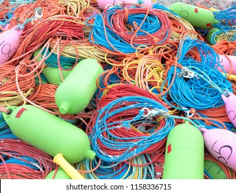 Colorful industrial fishing ropes and buoys.