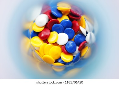colorful industrial plastic pellet in test tube background
