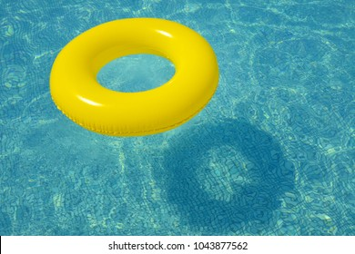 Colorful inflatable tube floating in swimming pool, summer vacation concpet