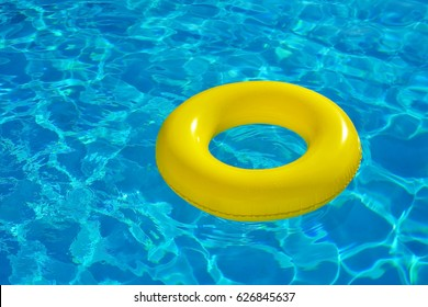 Colorful inflatable tube floating in swimming pool, summer vacation concept