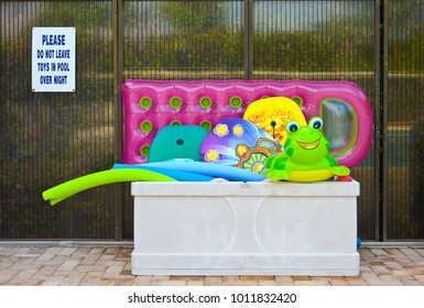 Colorful Inflatible Pool Floats in a storage box on the Swimming Pool Deck