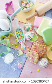 Colorful ingredients for baking and decorating easter cookies