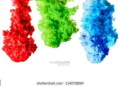 Colorful inks in water isolated on white background. Paint texture. Rainbow of colors