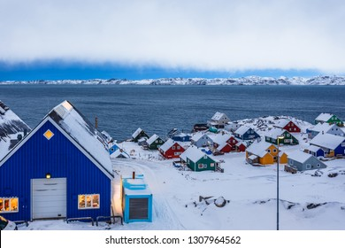 Colorful inuit huts among rocks and snow at the fjord in a suburb of arctic capital Nuuk, Greenland88