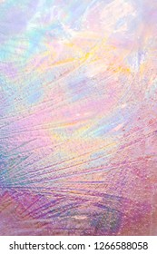Colorful iridescent ice texture with air bubbles. Holographic colors