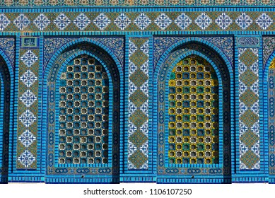 Colorful Islamic patterns, window covered with Arabic  screen, mosaic tiles. Dome of the Rock, Temple Mount mosque, Jerusalem, Israel