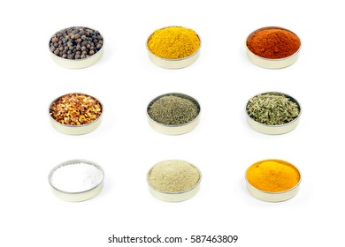 Colorful isolated spices and teas in a nine by nine grid on a pure white background, including black peppercorns, red pepper flakes, turmeric, dill, parsley, matcha, sea salt, curry, and paprika.