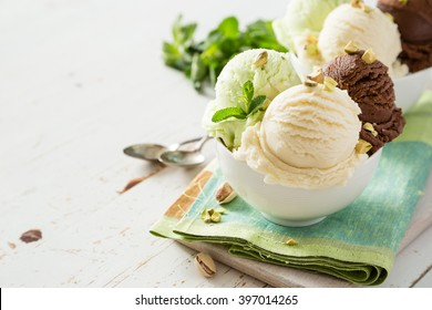 Colorful ive cream scoops in white bowl, copy space