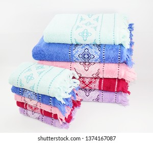 Colorful jacquard cotton towel set isolated on white background. Solid jacquard towel having beautiful border.