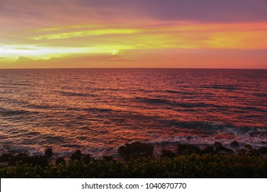 Colorful Jamaican sunset over the Caribbean Sea. Taken in Lucea, Jamaica.