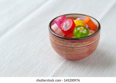 colorful japanese handmade candy in a cup, space for text