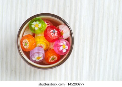 colorful japanese handmade candy, space for text, view from top, flat lay.