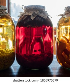 Colorful jars of homemade preservatives