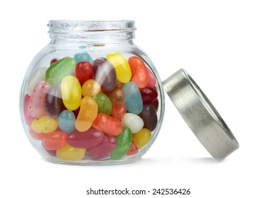 Colorful jelly beans in a jar isolated on white.