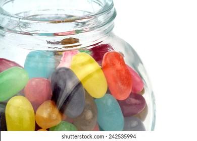 Colorful jelly beans in jar . Macro shot.