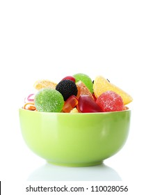colorful jelly candies in green bowl isolated on white