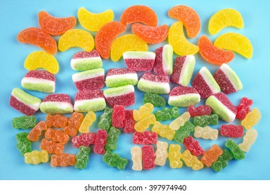 Colorful Jelly Candies on Blue Background.