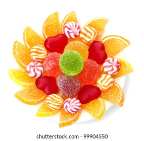 colorful jelly candies on plate isolated on white