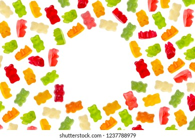 Colorful jelly candy gummy bears on white background with copy space of round shape