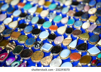 Colorful jewel pendants in Indian flea market.