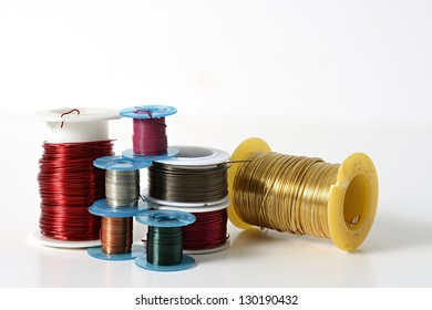Colorful Jewelry Wire on Spools on a White Background With Room For Text