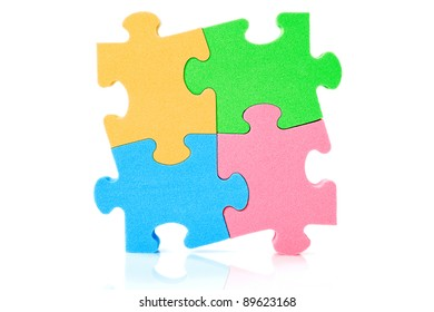 Colorful jigzaw puzzle,  over a white background