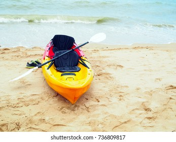 A colorful kayak on the beautiful beach with selective focus.