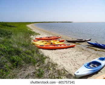 Colorful kayaks on the beach at the dunes of the Tisbury Great Pond in Martha's Vineyard, a Massachusetts island at the Atlantic just south of Cape Cod in the United States of America