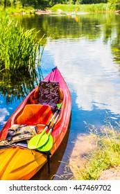 Colorful kayaks on the river trail Krutyn. Poland