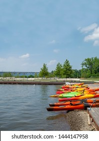 Colorful kayaks sit at the rivers edge at Long Dock Park in Beacon, New York.  The Newburgh Beacon Bridge can be seen in the background.