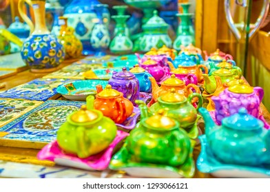 The colorful kettles, plates and painted tiles in a pottery stall in Grand Bazaar of Isfahan, Iran