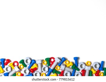 Colorful kids toys background with plastic toy bolts and nuts