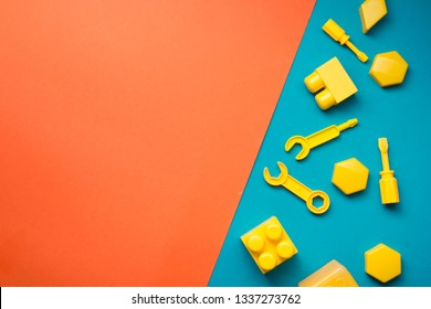Colorful kids toys frame on wooden background. Top view. Flat lay. Copy space for text