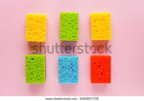 Colorful kitchen cleaning set sponge background