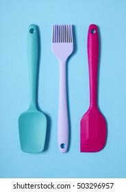 colorful kitchen utensils. Perfect Kitchen Colorful Kitchen Utensils On A Bright Blue Background For Kitchen Utensils