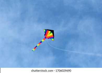 A colorful kite flying in a blue sky