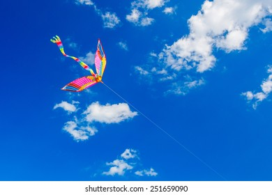 Colorful kite flying in the wind.
