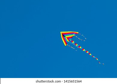 Colorful kite hovering in the sky.
