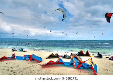 Colorful Kite surfing equipment laying  on a white sand beach at Boracay in the Philippines