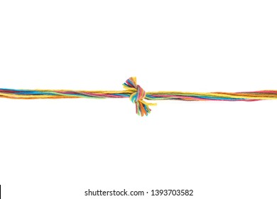 Colorful knot of cotton thread isolated on white background. Thread line with knot made of different color pink, green, yellow, blue, orange thread mix.