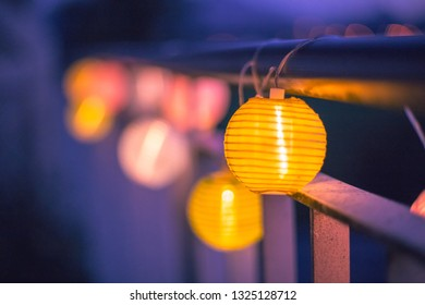 Colorful lampions outside, twilight hour, garden party