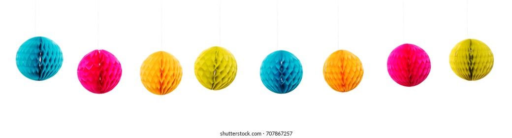 colorful lampions in a row, isolated in front of white background