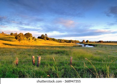 Colorful landscape of grass field and golden shade of sunset at Capalaba Redland